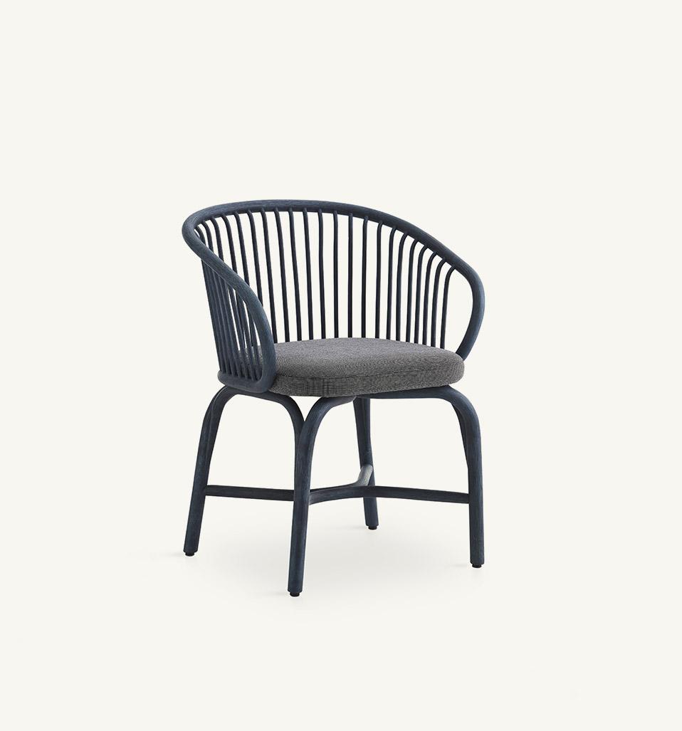 Huma dining armchair with rattan legs